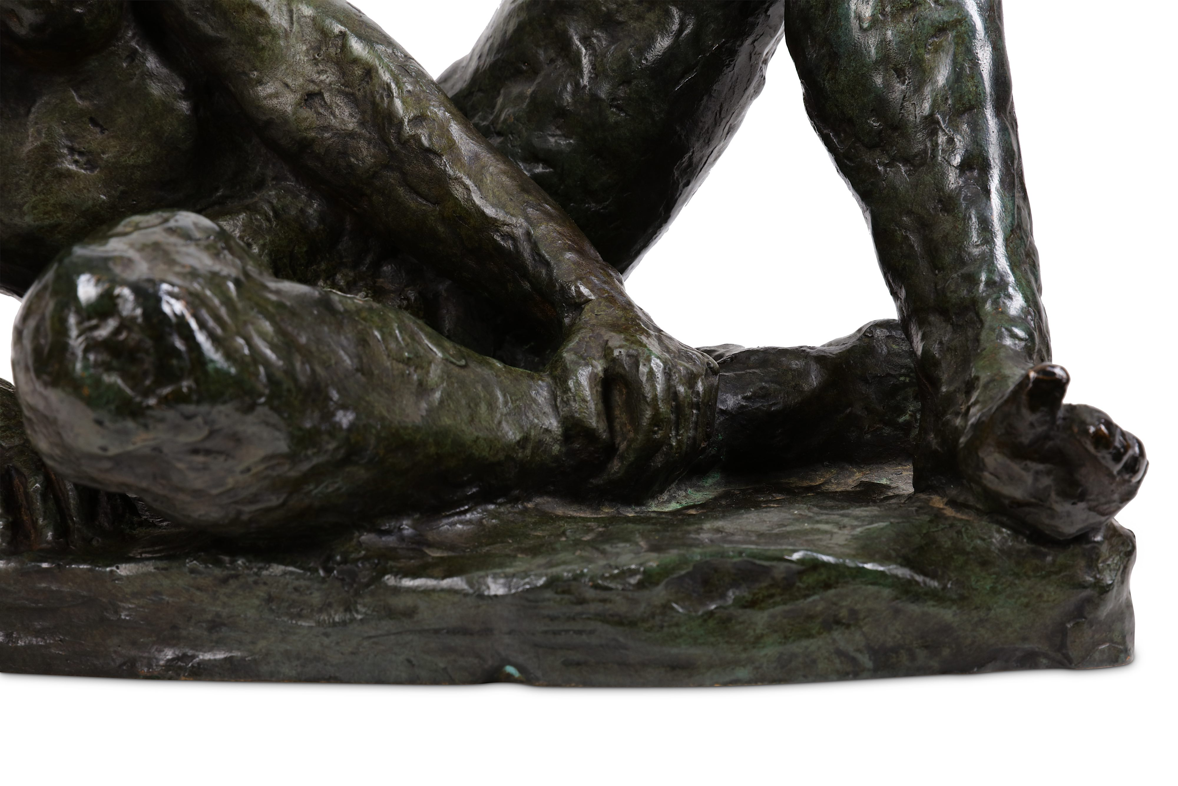 A 20TH CENTURY BRONZE FIGURE OF A NUDE GIRL the reclining