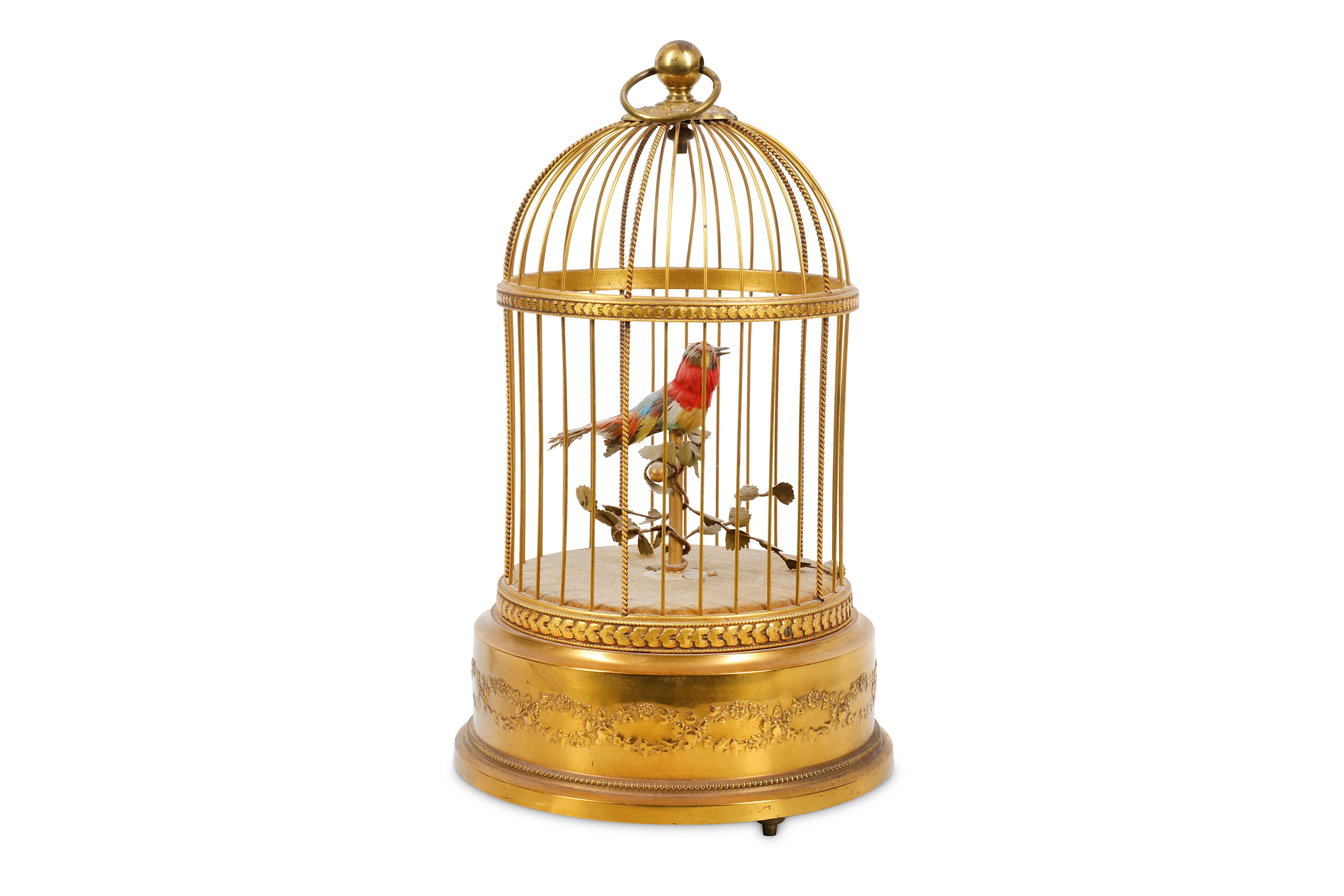 Lot 7 - A SMALL EARLY 20TH CENTURY FRENCH GILT METAL SINGING BIRD IN CAGE AUTOMATON