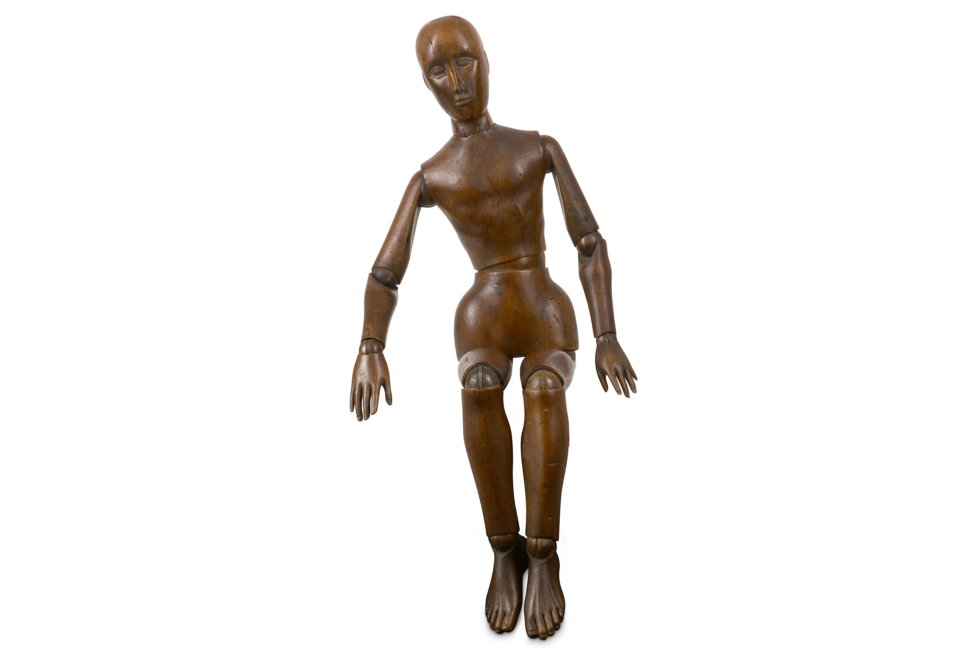 Lot 28 - AN EARLY 20TH CENTURY CARVED AND STAINED WOOD LAY FIGURE OR ARTIST'S MANNEQUIN
