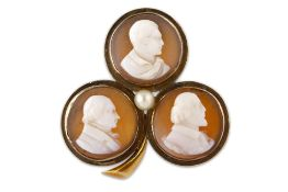 A COMMEMORATIVE CARVED SHELL CAMEO BROOCH OF BYRON AND TWO BRITISH POETS