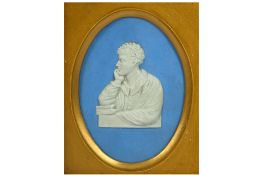 A SMALL OVAL WEDGWOOD PORCELAIN BLUE AND WHITE BUST OF LORD BYRON