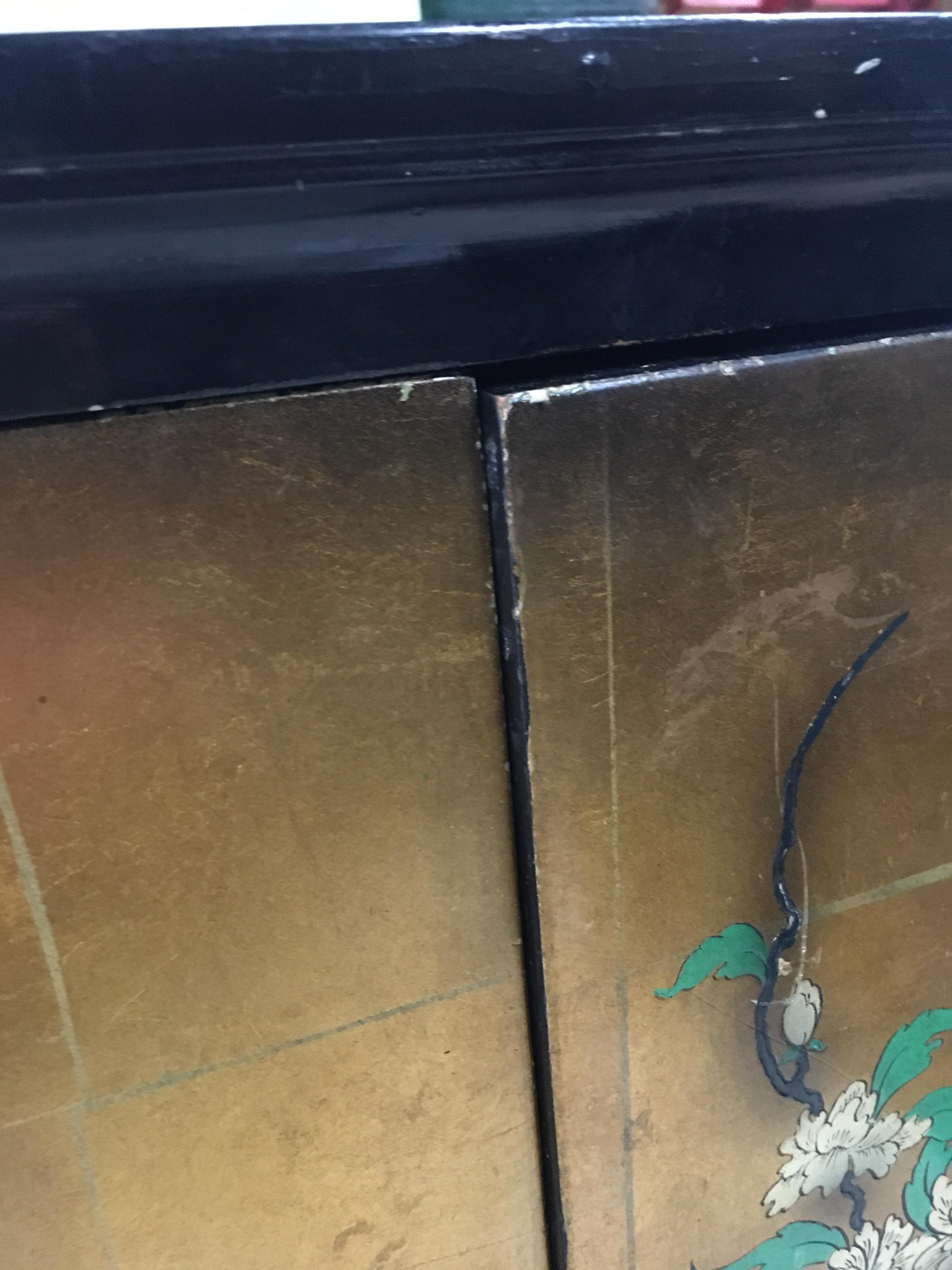 Lot 16 - A circa 1970's Japanese inspired black lacquered sideboard