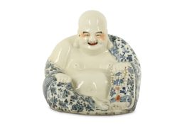 A CHINESE PORCELAIN FIGURE OF BUDAI HESHANG.