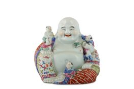 A CHINESE FAMILLE ROSE FIGURE OF BUDAI HESHANG WITH FIVE BOYS.