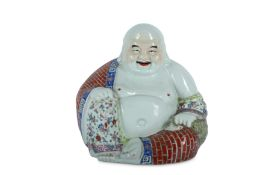 A CHINESE FAMILLE ROSE FIGURE OF BUDAI HESHANG.