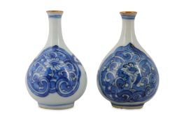 TWO CHINESE BLUE AND WHITE BOTTLE VASES.