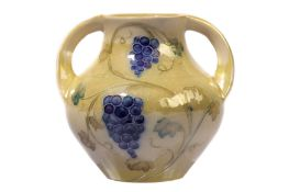 WILLIAM MOORCROFT for LIBERTY & CO: a lustre two handled vase,