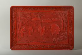 A CINNABAR LACQUERED 'ELEPHANT' TRAY.