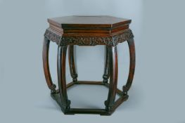A CHINESE HEXAGONAL CARVED WOOD STAND.