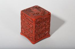 A CHINESE CINNABAR LACQUER THREE-TIERED BOX AND COVER.