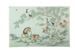 A CHINESE FAMILLE ROSE RECTANGULAR 'DEER AND CRANE' PLAQUE.