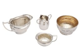 A mixed group of sterling silver milk jugs and a sugar bowl
