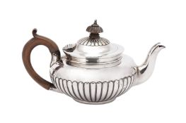 A Victorian sterling silver bachelor teapot, London 1883 by Jackson & Chase