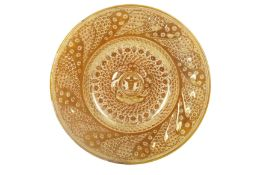 AN HISPANO-MORESQUE REVIVAL COPPER-LUSTRE POTTERY CHARGER