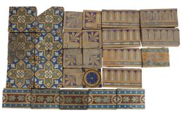 A collection of various Victorian encaustic tiles