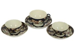A near pair of 18th century Worcester porcelain tea bowls and saucers,
