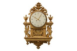 A 19th century and later Swedish giltwood wall clock in the Empire style