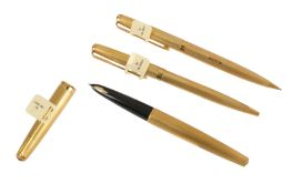 A set of three 18ct gold Parker pens,