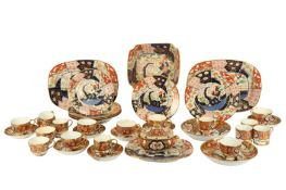 A pair of 19th century English Imari pattern porcelain oval chargers,