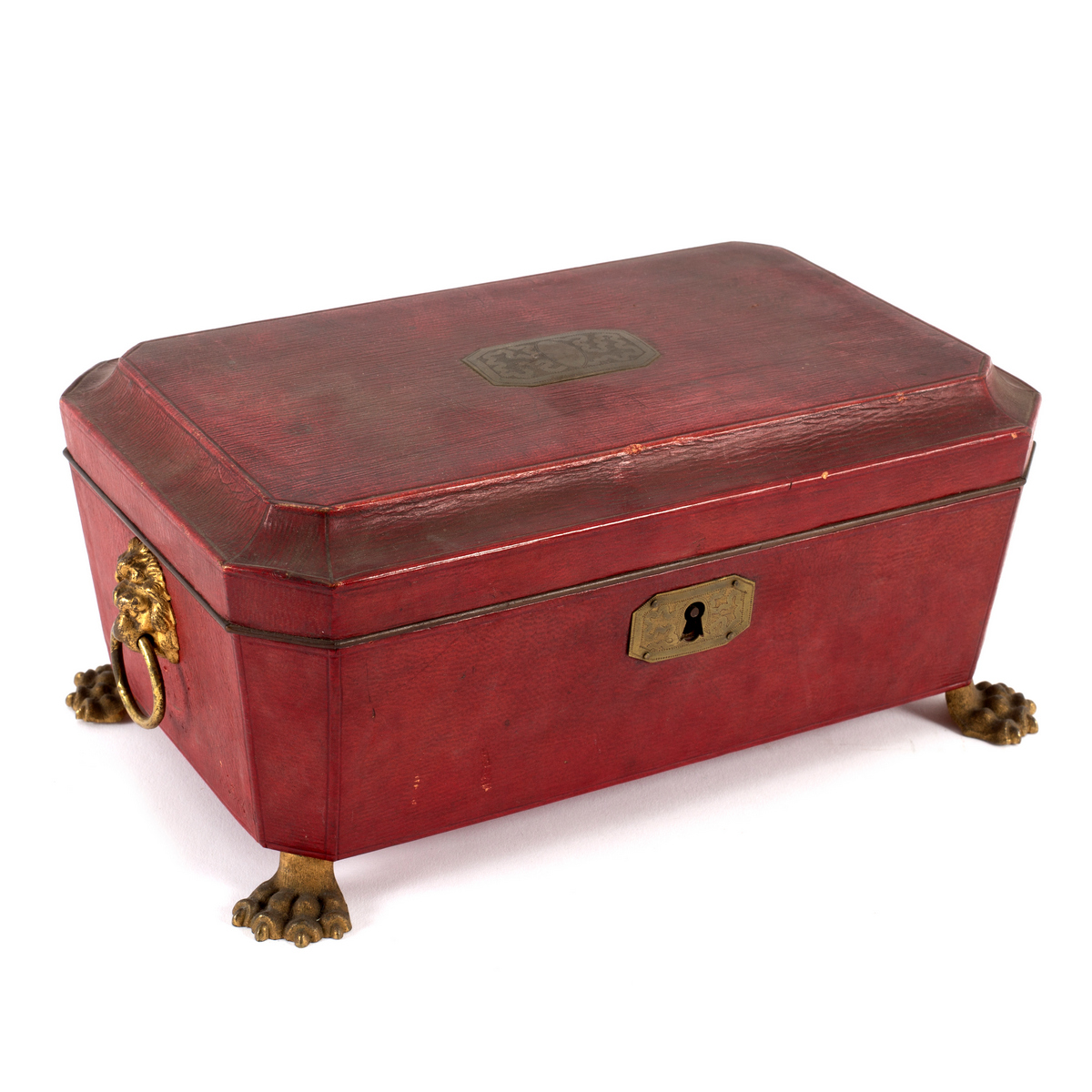 Lot 574 - A Regency leather covered sewing box with brass lion mask ring handles and paw feet,