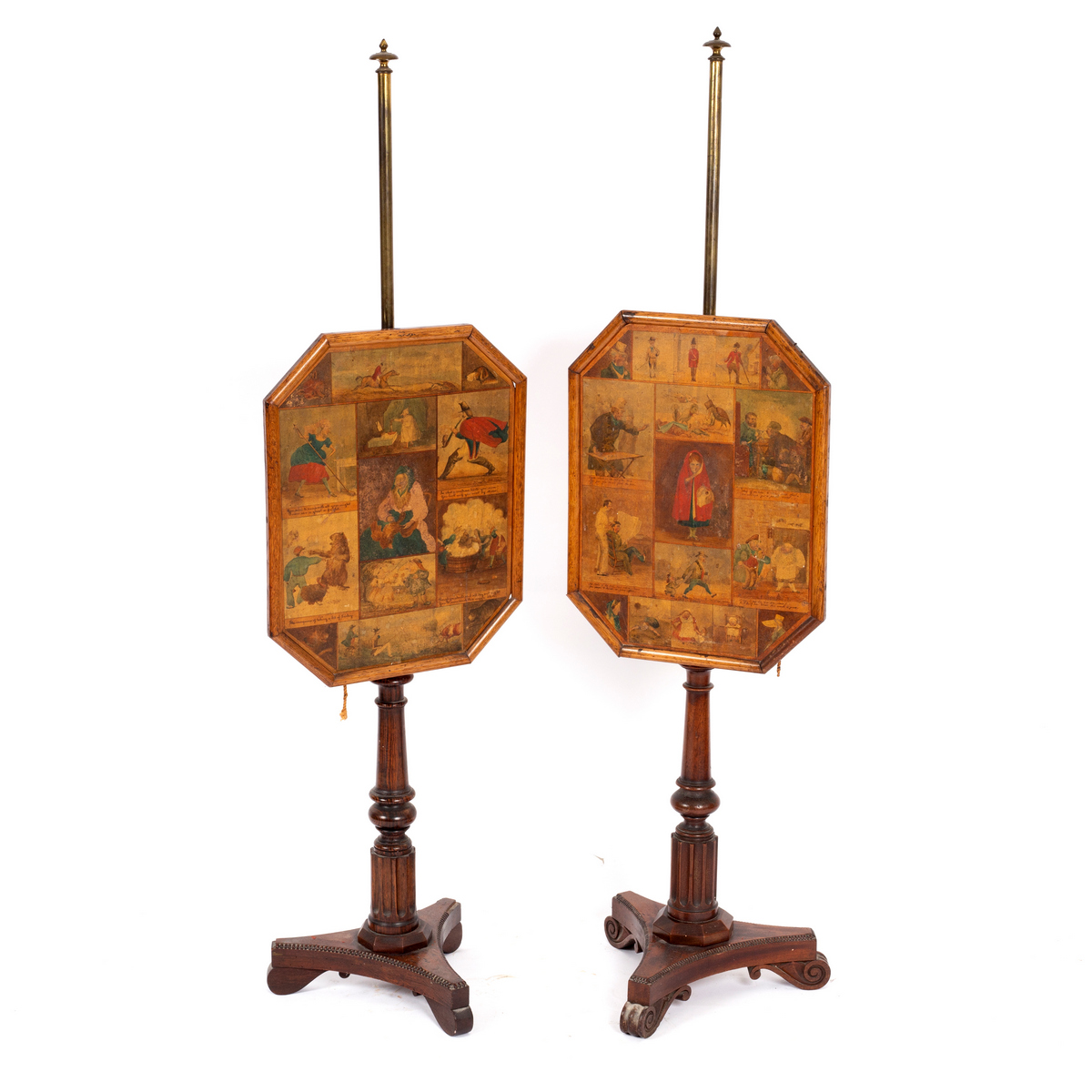 Lot 647 - A pair of William IV simulated rosewood pole screens,