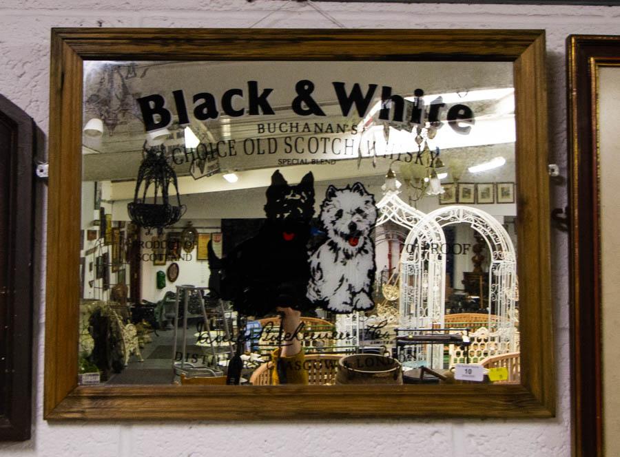 Lot 10 - BLACK + WHITE ADVERTISING MIRROR 68 X 52