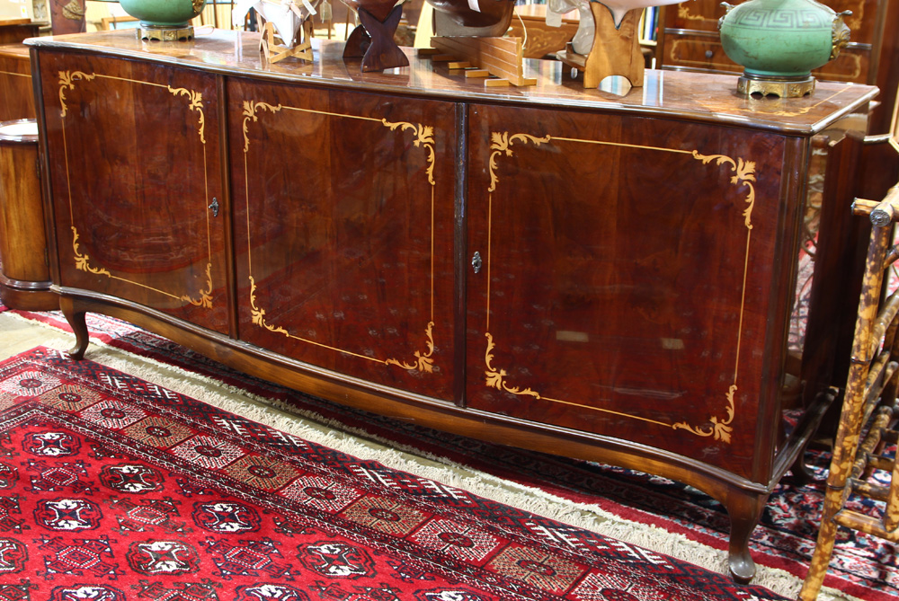 Lot 4586 - Louis XVI style inlaid buffet, the serpentine case having marquetry reserves and rising on