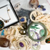 A collection of multi-stone, gold and metal jewelry