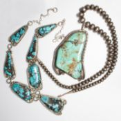 A group of turquoise and silver necklaces