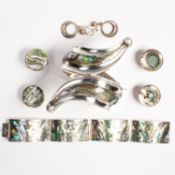 A group of abolone shell and silver jewelry, incl. Mexican