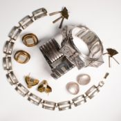 A group of silver and mixed metal jewelry