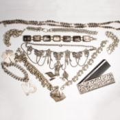 A group of silver jewelry and accessories