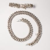 A Mexican silver necklace and bracelet suite
