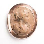 A lava cameo and nine karat gold brooch, Forster