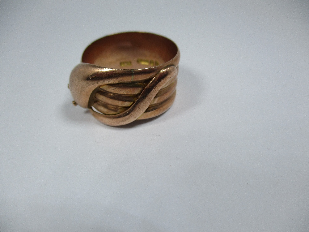 Lot 23 - A 9ct rose gold ring in the form of a coiled snake, approx weight 6.8g