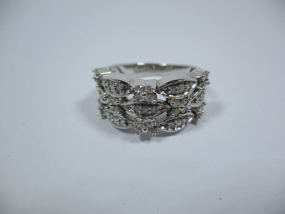 Lot 3 - A 9ct white gold and diamond dress ring, approx finger size O