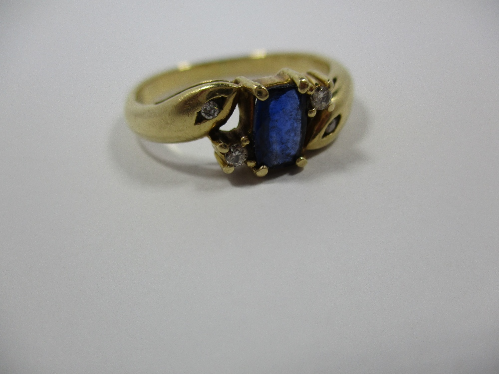 Lot 12 - An 18ct yellow gold ring set with 4 diamonds and central blue sapphire, approx finger size 'S'