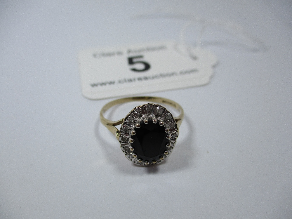 Lot 5 - A 9ct gold diamond and dark blue sapphire cluster ring, approx finger size O
