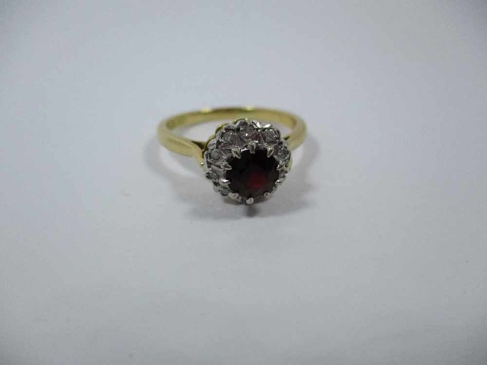 Lot 6 - An 18ct gold diamond and garnet daisy ring, approx finger size O1/2