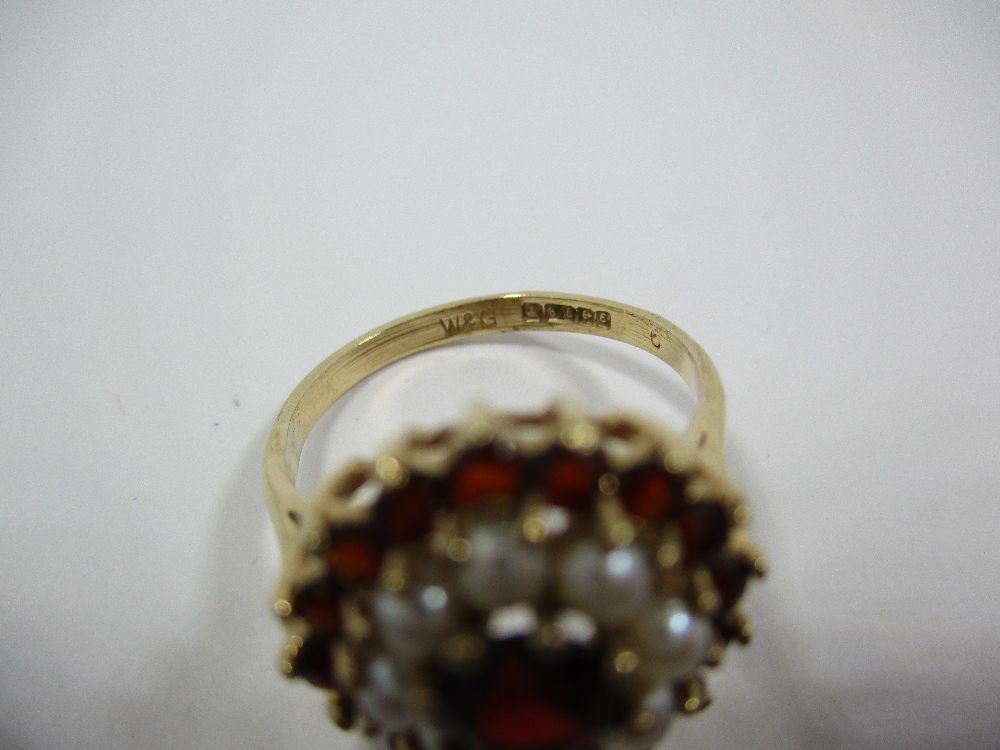Lot 7 - A 9ct gold garnet and seed pearl daisy ring, approx finger size N