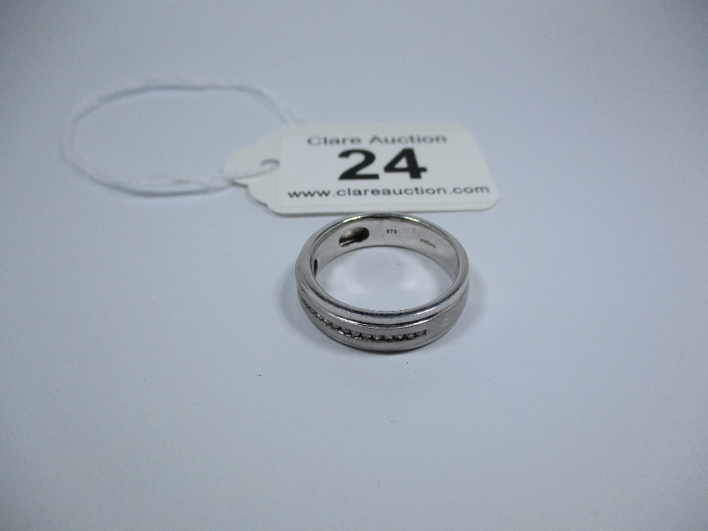 Lot 24 - A gents 9ct white gold diamond set ring, approx finger size S