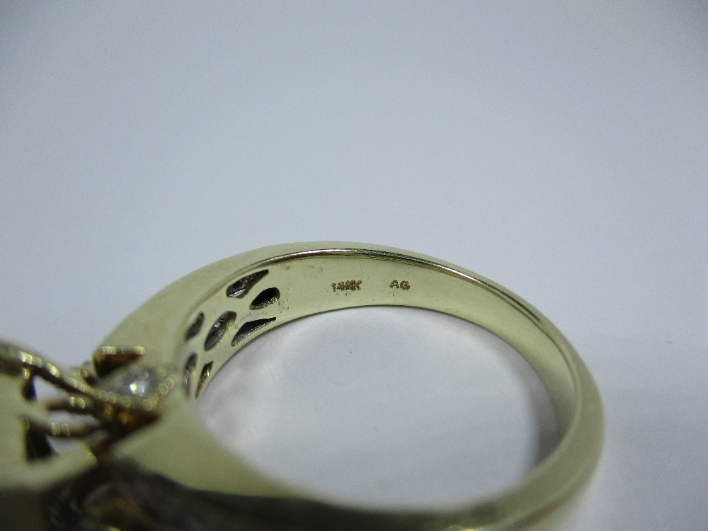 Lot 19 - A 14ct gold ring set with multiple diamonds