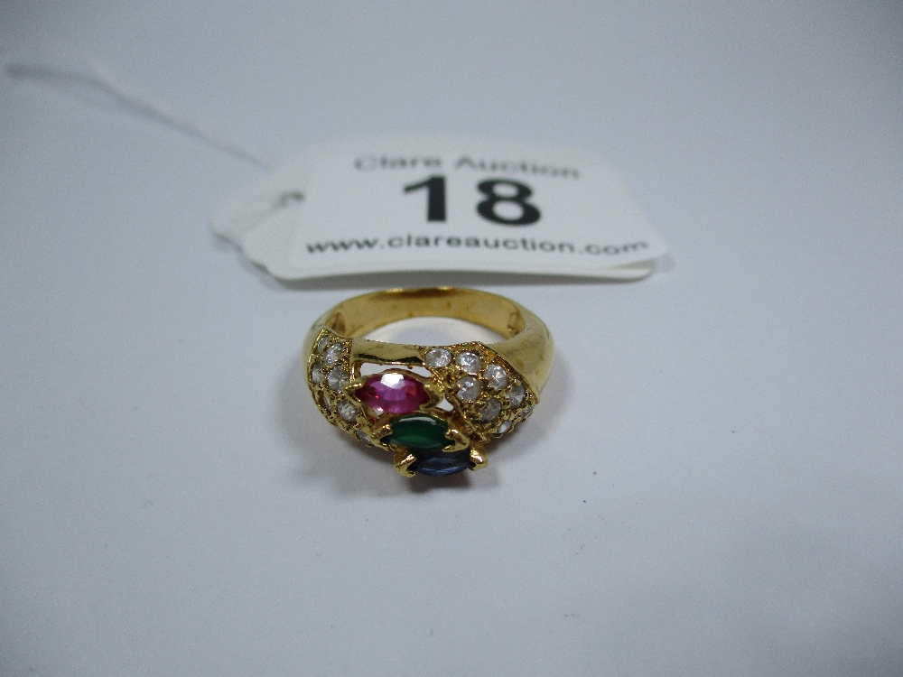 Lot 18 - A yellow metal ring set with various stones