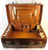 A substantial fitted leather vanity case with silv