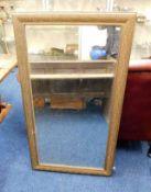 A 19thC. gilt framed mirror 53.75in high x 29.5in