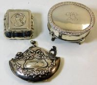 Two silver boxes twinned with a silver purse appro