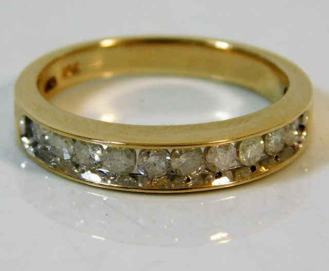 Lot 337 - An 18ct gold half eternity ring set with approx. 0