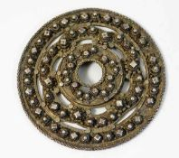 "A white metal roundel with applied similar ""jewels"