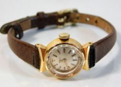 A ladies 18ct gold cased Tissot wrist watch