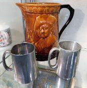 A Falconware ale pitcher twinned with two Victoria